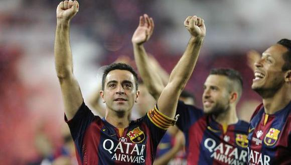 Xavi se convirtió en el primer jugador español en ganar 24 títulos. (AFP)