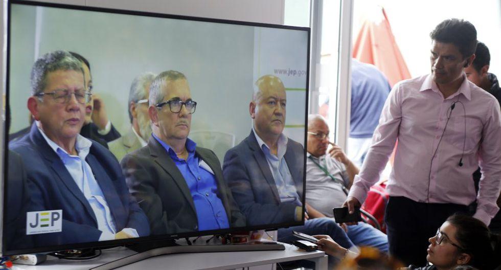 Solo Timochenko y los también dirigentes Pablo Catatumbo y Carlos Lozada asistieron a la audiencia. (Foto: AP)