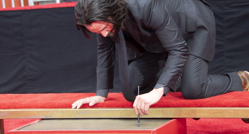 Keanu Reeves estampó sus huellas en el Paseo de la Fama (Foto: AFP)