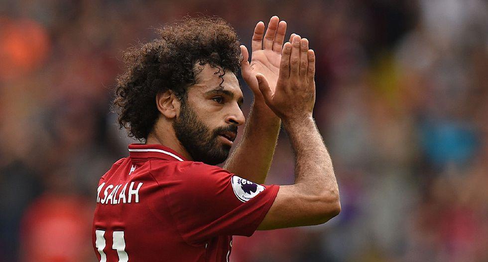 Mohamed Salah y su gesto con pequeño hincha del Liverpool. (Foto: AFP)
