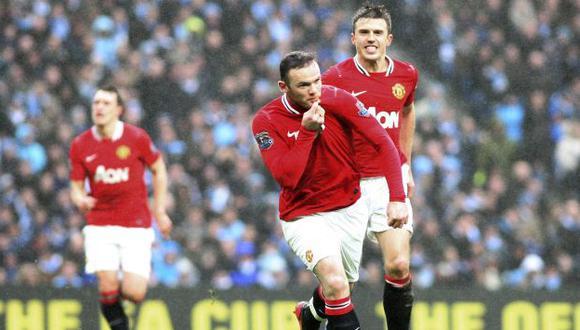 Rooney hizo dos. (AP)