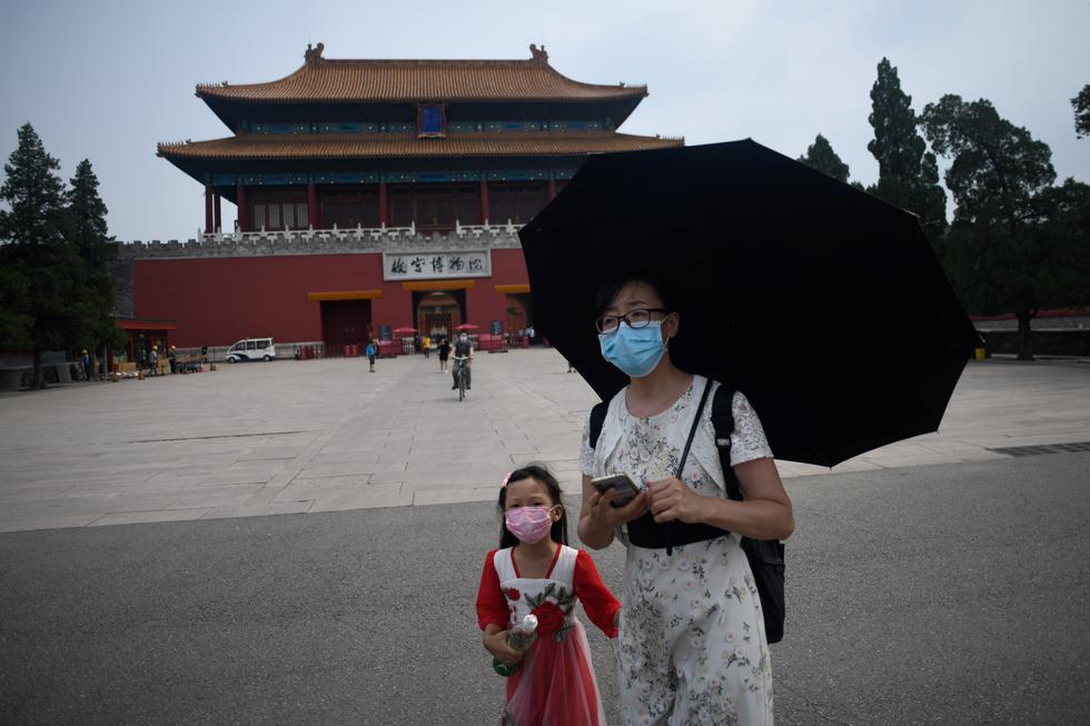 En la Ciudad Prohibida todavía será obligatorio reservar las entradas en línea, pasar controles de temperatura al acceder al recinto, llevar mascarillas y respetar la distancia social. (Foto:  WANG Zhao / AFP)