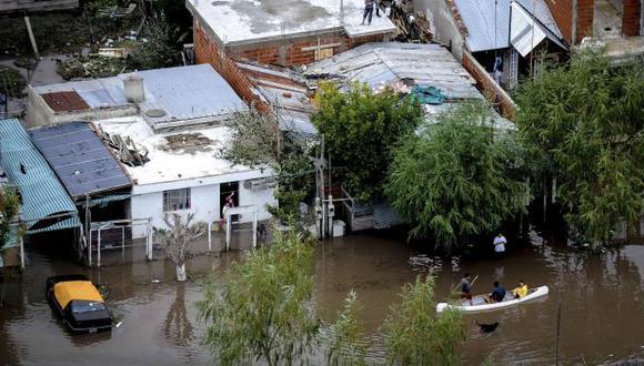 Víctimas de fuertes lluvias. (Reuters)
