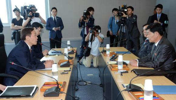 Representantes coreanos en una reunión previa. (AFP)