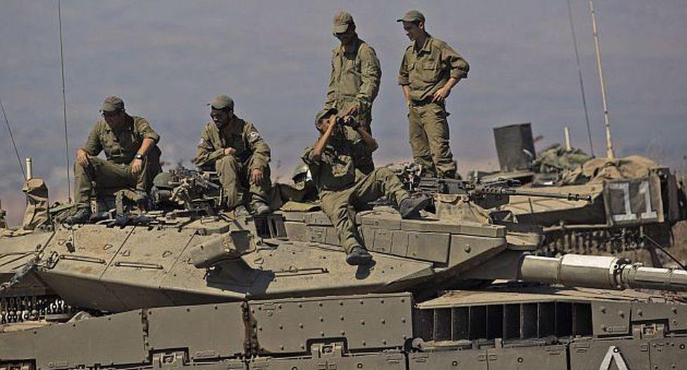 Otros 81 efectivos estaban atrapados en el área. (EFE)