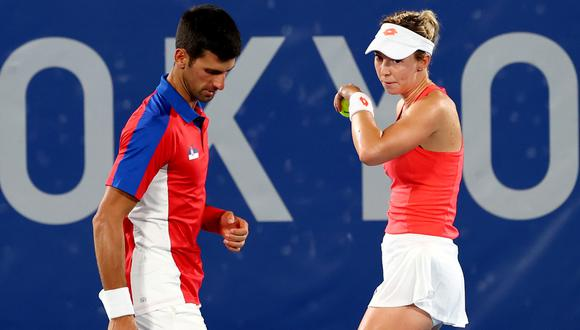 Tokyo 2020 Olympics - Tennis - Mixed Doubles - Round 1 - Ariake Tennis Park - Tokyo, Japan - July 28, 2021. Nina Stojanovic of Serbia and Novak Djokovic of Serbia react during their first round match against Luisa Stefani of Brazil and Marcelo Melo of Brazil REUTERS/Mike Segar