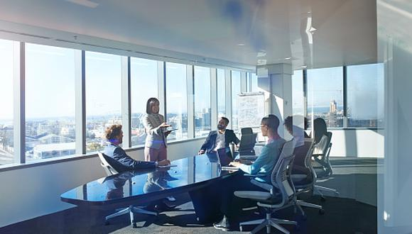 Modern chic business people working in an incredible futuristic & original office space