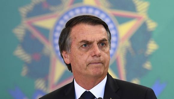 El presidente brasileño, Jair Bolsonaro, pronuncia un discurso durante la ceremonia de nombramiento de los nuevos jefes de los bancos públicos, en el Palacio Planalto de Brasilia. (AFP/EVARISTO SA).