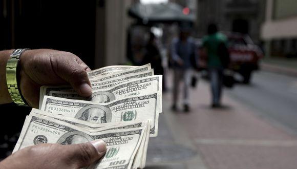 El dólar registraba una subida marginal en la jornada. (Foto: GEC)