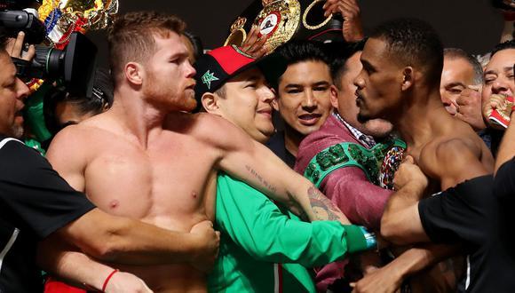 Canelo y Jacobs protagonizan la pelea estelar hoy por el título peso medio del CMB en Las Vegas. (AFP)