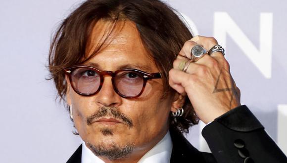 """Johnny Depp denunció a diario The Sun por llamarlo """"maltratador de esposas"""" en nota sobre supuesta agresión a Amber Heard. (Foto: Eric Gaillard / AFP)"""