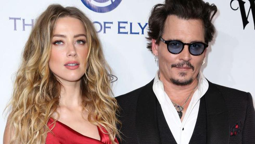 Filtran video de Johnny Depp agresivo con Amber Heard. (AP)