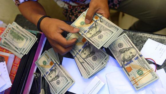 El tipo de cambio del dólar en el país pasó los S/ 3.60. (Foto: AFP)