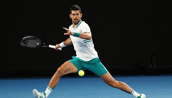 MELBOURNE, AUSTRALIA - FEBRUARY 14: Novak Djokovic of Serbia plays a forehand in his Men's Singles fourth round match against Milos Raonic of Canada during day seven of the 2021 Australian Open at Melbourne Park on February 14, 2021 in Melbourne, Australia. (Photo by Cameron Spencer/Getty Images)