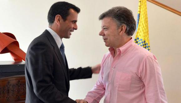 REUNIÓN PRIVADA. El encuentro Santos-Capriles ha desatado la ira del Gobierno venezolano. (EFE)