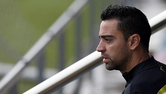 DT Luis Enrique y el presidente Josep Bartomeu lo convencieron de quedarse en el club. (Reuters)
