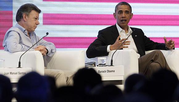 Obama participó junto a Santos en el Foro Económico previo a la cumbre. (AP)