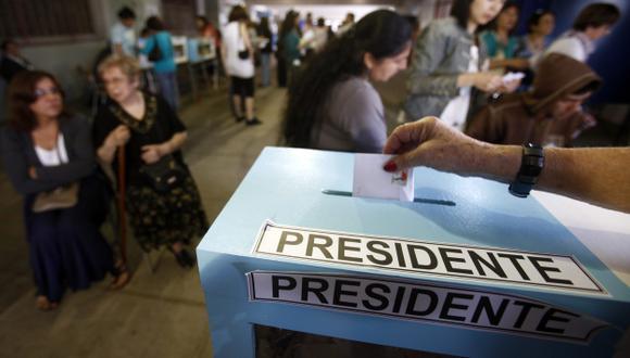 VOTO VOLUNTARIO. Chilenos se han mostrado apáticos políticamente al no estar obligados a sufragar. (EFE)