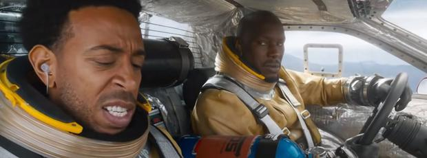 Roman (Tyrese Gibson) and Tej (Ludacris) are blown up into the atmosphere and fly what appears to be a rocket (Photo: Universal Studios)