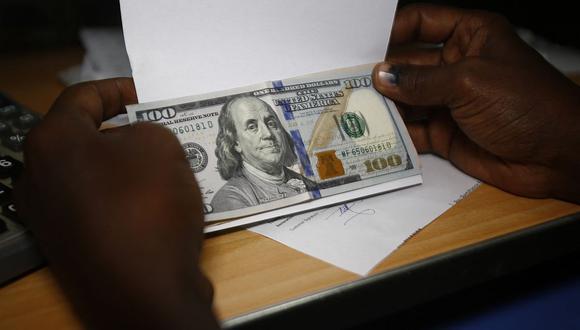 En el mercado paralelo o casas de cambio de Lima, el tipo de cambio se cotizaba a S/ 3.635 la compra y S/ 3.660 la venta. (Foto: AFP)