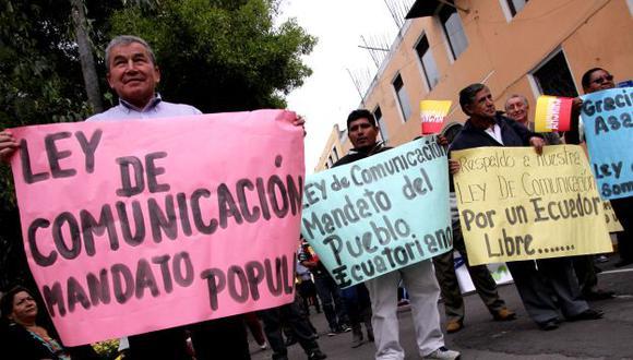A SOLA FIRMA. Falta que la norma sea promulgada por Rafael Correa para que entre en vigencia. (AFP)