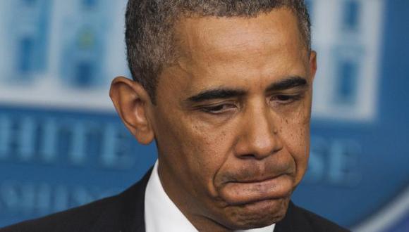 Solidario. Obama dio sentidas palabras a familia de la víctima. (AFP)