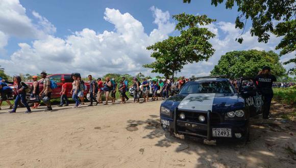 El funcionario explicó que por ser centroamericanos los hondureños tienen la potestad de ingresar haciendo su trámite migratorio. | Foto: AFP