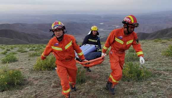Los equipos de rescate confirmaron la muerte de hasta 20 de los corredores, en medio del granizo, la lluvia helada y los vendavales. (Foto: STR / AFP / China OUT)