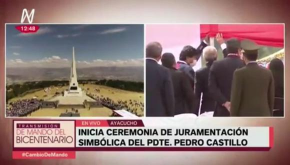 Evo Morales y Alberto Fernández, junto a otros invitados, ayudaron a retirar parte del toldo en Ayacucho. (América TV)