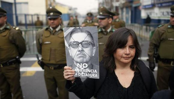 """Opositores gritaban """"asesino"""". (Reuters)"""