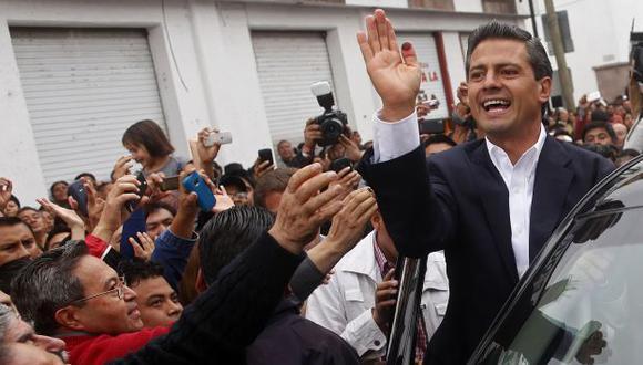 LO HIZO. Peña Nieto, un carismático abogado de 45 años, regirá los destinos de México hasta el 2018. (AP)