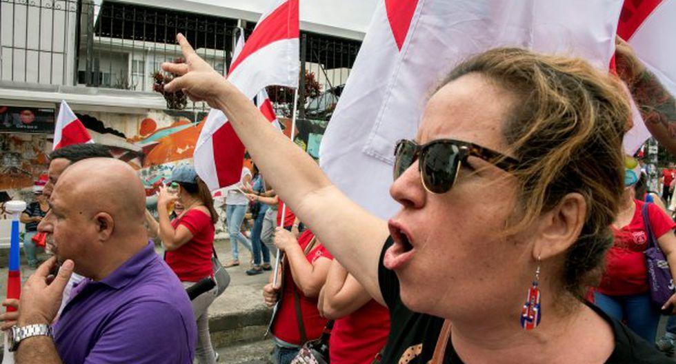 Funcionarios costarricenses se manifestaron durante una huelga contra la propuesta tributaria, que se está discutiendo en el Congreso en San José. (Foto: AFP)