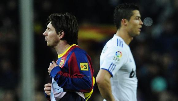 DUELO. Messi y Cristiano Ronaldo luchan por ser el mejor. (AP)