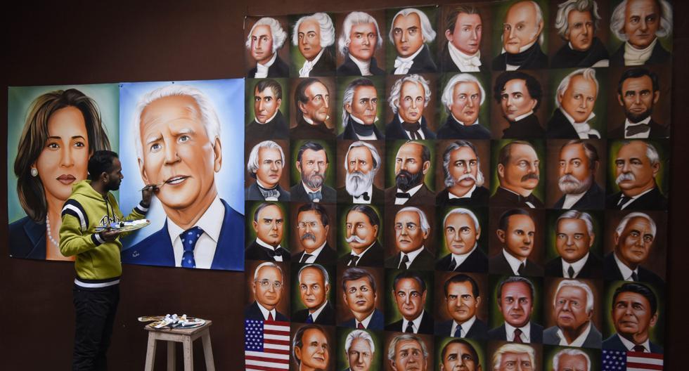 Imagen referencial. Jagjot Singh Rubal da los toques finales a una pintura que representa al presidente electo de Estados Unidos, Joe Biden, y a la vicepresidenta electa Kamala Harris en Amritsar, el 19 de enero de 2021. (NARINDER NANU / AFP).
