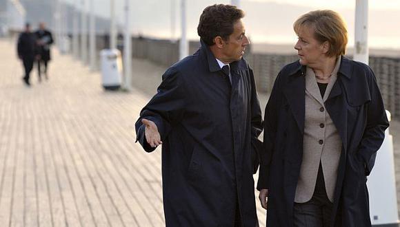 Sarkozy y Merkel coincidieron en que será un año complicado para la Eurozona. (AP)
