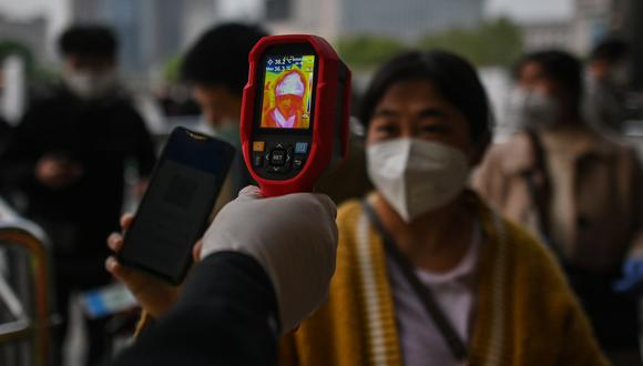 Coronavirus no será eliminado en su totalidad y volverá cada año según científicos chinos. (AFP)