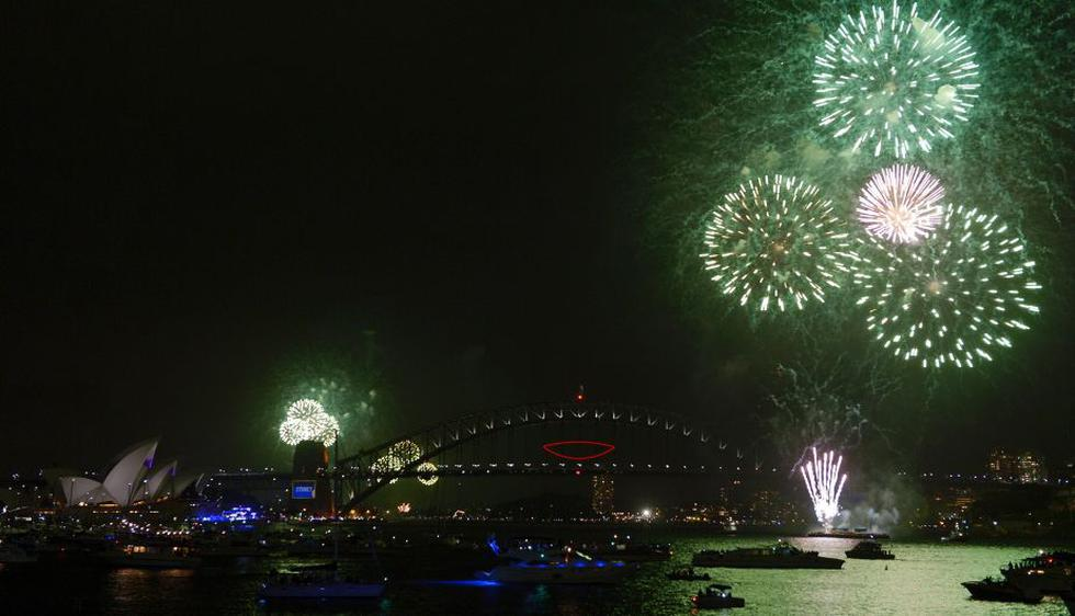 Miles de personas participaron en los actos organizados en la emblemática Casa de la Ópera de Sídney, en Australia. (AFP)