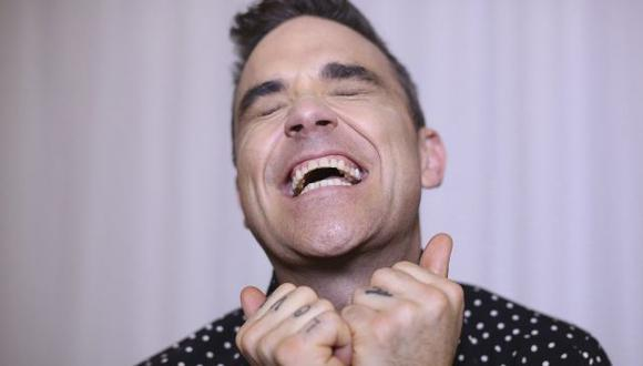 El cantante Robbie Williams se burla de las críticas. (EFE)