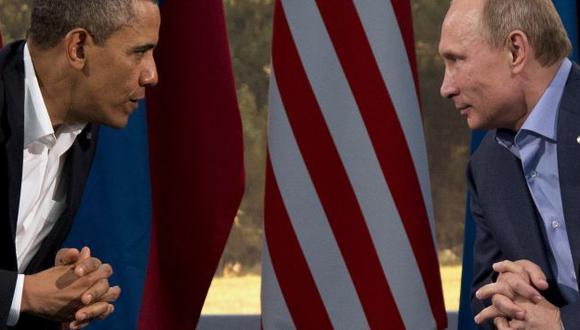 Barack Obama y Vladimir Putin durante una reunión en Enniskillen, Irlanda. (EFE)