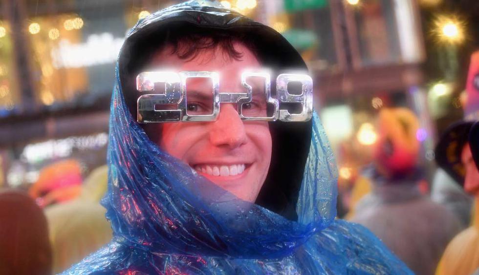 Los manifestantes desafían la lluvia para disfrutar de la celebración de la víspera de Año Nuevo el 31 de diciembre de 2018 en Times Square. (Foto: AFP)