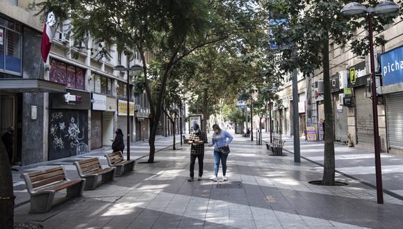"""El anuncio llega en un escenario epidemiológico que las mismas autoridades chilenas han catalogado de """"favorable"""". (Foto:  MARTIN BERNETTI / AFP)"""