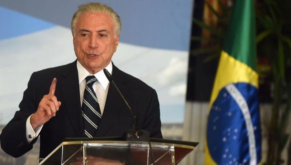 """En su discurso, Temer agradeció a """"Dios"""", a su """"familia"""", a sus """"ministros"""" y a """"todos los brasileños"""", tanto los que le apoyaron como aquellos que eran críticos. (Foto: AFP)."""