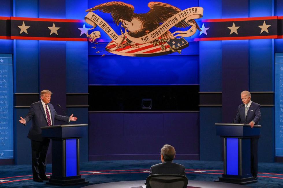 El presidente de los Estados Unidos, Donald Trump y el candidato presidencial demócrata y exvicepresidente de los Estados Unidos, Joe Biden. (AFP/Jim WATSON).