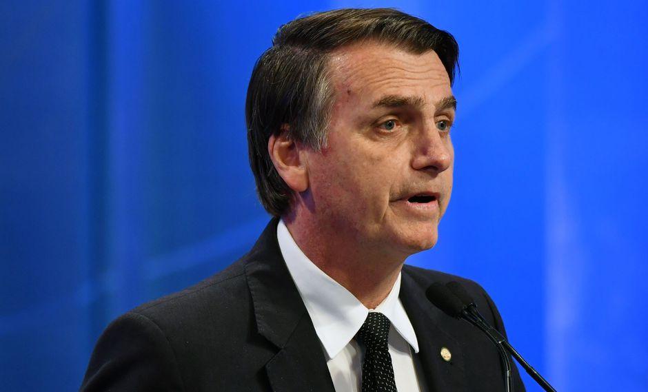 Bolsonaro subió cuatro puntos porcentuales al 36% de la intención de voto, mientras que Haddad cayó un punto a un 22%, según la encuestadora Ibope. (Foto: AFP)