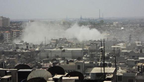 Enfrentamientos en un barrio de Homs. (AP)