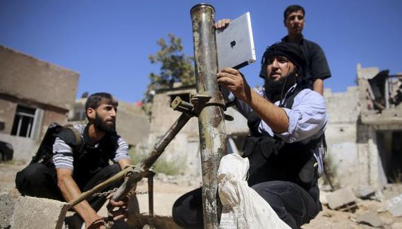 Partidarios de Assad dicen que pasarán sobre sus cadáveres. (Reuters)