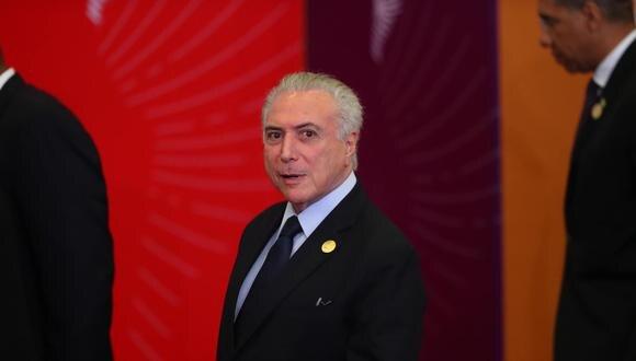 El mandatario de Brasil participa en la cumbre en Perú.