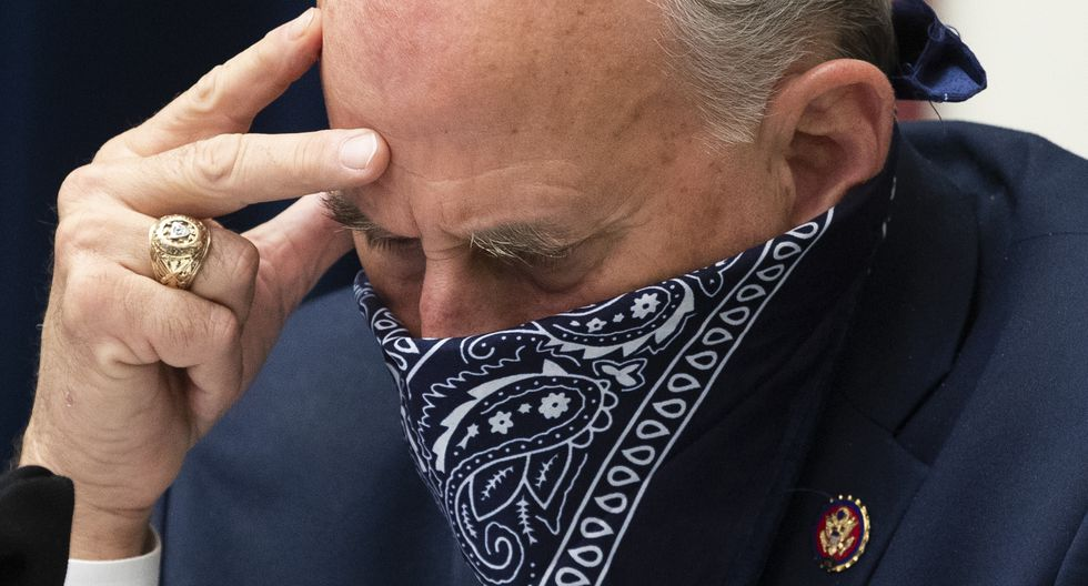 """Republican Representative of Texas Louie Gohmert uses a face covering during the US House Natural Resources Committee hearing on """"The US Park Police Attack on Peaceful Protesters at Lafayette Square"""", on Capitol Hill in Washington, DC, on June 29, 2020. (Photo by MICHAEL REYNOLDS / POOL / AFP)"""
