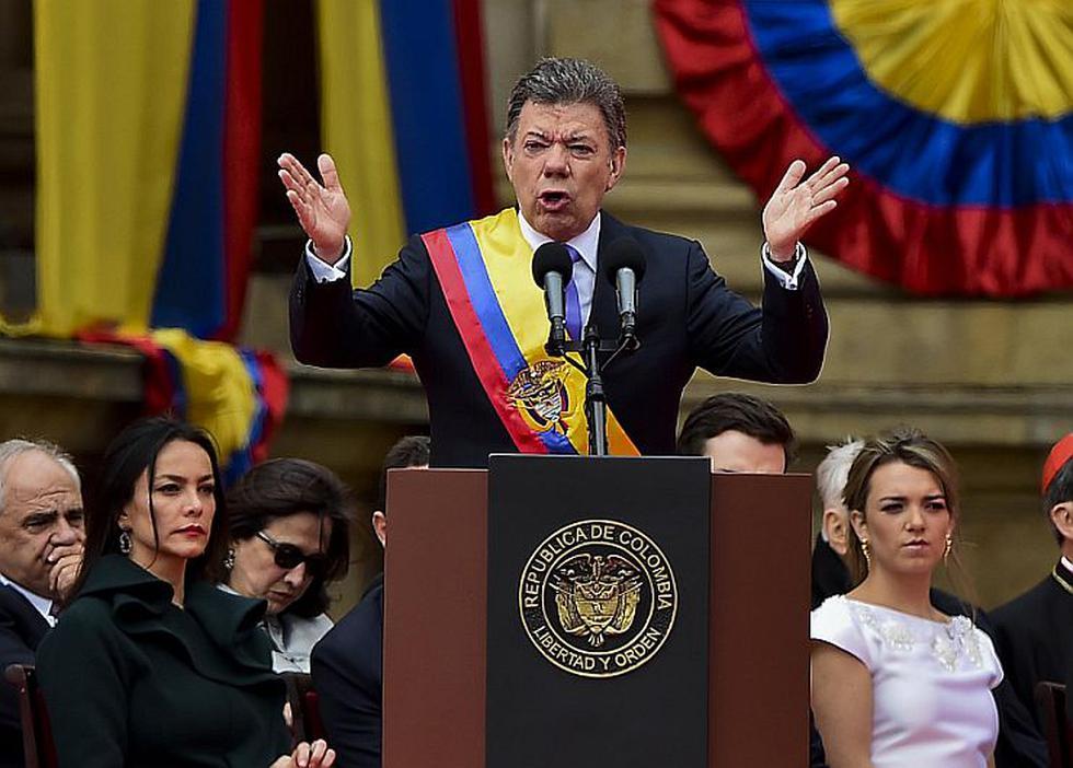 Presidente de Colombia, Juan Manuel Santos, inició su segundo período con un duro mensaje a las FARC para pacificar a su país. (AFP)