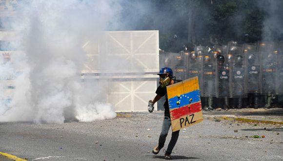 Guaidó anunció formalmente esta protesta el 18 de octubre. La única vez que el opositor había convocado una actividad con tanta antelación había sido para intentar ingresar ayuda humanitaria al país el pasado 23 de febrero. (Foto: AFP)